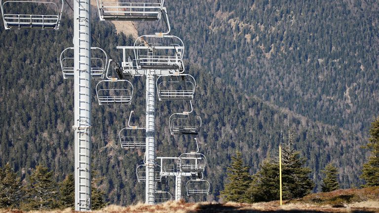 Chairlifts have been left empty as the slopes are closed