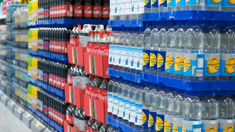Supermarket shelves stacked with drinks