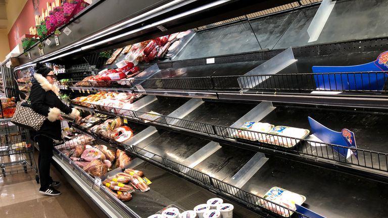 Meat shelves lay empty at a supermarket in Saugus, Massachusetts on March 13, 2020. - Supermarkets and shops around Boston have been emptied by customers in fear of Covid-19. (Photo by Joseph Prezioso / AFP) (Photo by JOSEPH PREZIOSO/AFP via Getty Images)