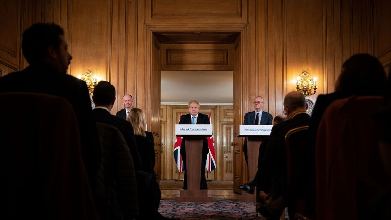 Chief Medical Officer Chris Whitty (L) and Chief Scientific Adviser Patrick Vallance (R) look on as Britain's Prime Minister Boris Johnson addresses a news conference to give a daily update on the government's response to the novel coronavirus COVID-19 outbreak, inside 10 Downing Street in London on March 19, 2020. (Photo by Leon Neal / POOL / Getty Images) (Photo by LEON NEAL/POOL/AFP via Getty Images)