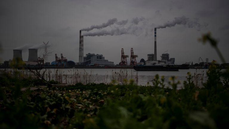 The Huangpu river and the Wujing Coal-Electricity Power Station in Shanghai are pictured on February 21, 2017
