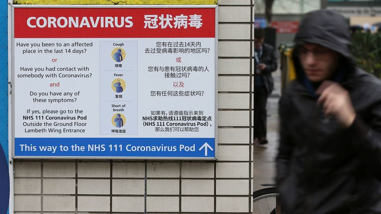 A sign directs patients towards an NHS 111 coronavirus (COVID-19) pod at St Thomas' Hospital in London