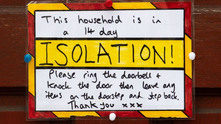 A sign on the front door of a house in self-isolation in Cardiff