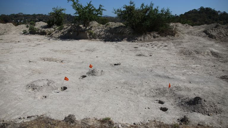 Small flags indicate where remains of a victim have been found