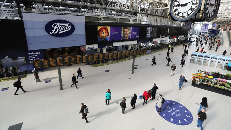 A quiet London Waterloo station on the day the government brought in further social distancing measures
