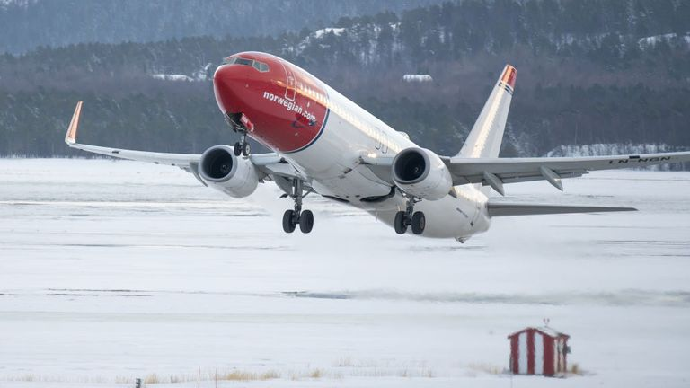 A Norwegian Air Boeing 737-800 plane takes off at Alta Airport in Finnmark county on February 17, 2019 in Alta, Norway