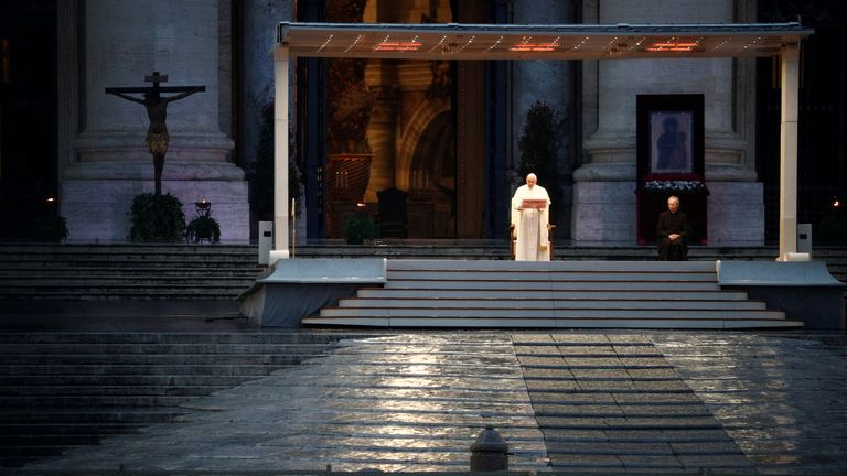 Pope delivers prayer in empty St Peter's Square