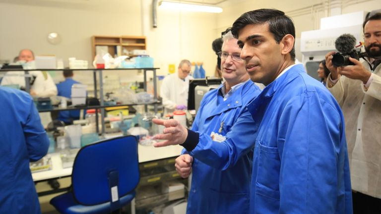 Chancellor Rishi Sunak is shown the testing of samples for respiratory viruses by Dr Antony Hale (L) during a visit to the pathology labs at Leeds General Infirmary on March 12, 2020 in Leeds, England