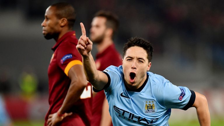 Manchester City's French midfielder Samir Nasri celebrates after scoring during the UEFA Champions League football match AS Roma vs Manchester City