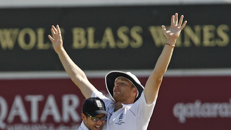England's Andrew Flintoff celebrates running out Australia's Captain Ricky Ponting (not pictured) with England's James Anderson(L) during the Australian 2n
