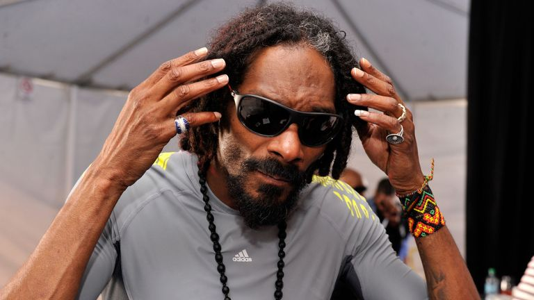 Rapper Snoop Dogg attends GBK and DirecTV Celebrity Beach Bowl Thank You Lounge at DTV SuperFan Stadium at Mardi Gras World