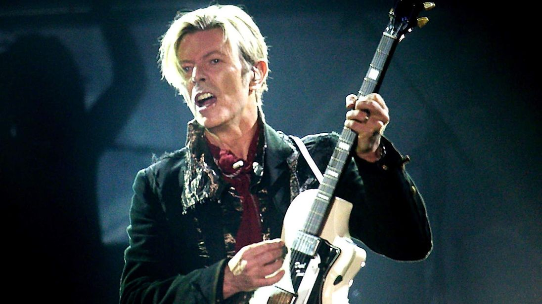 Rock legend David Bowie performs on stage.