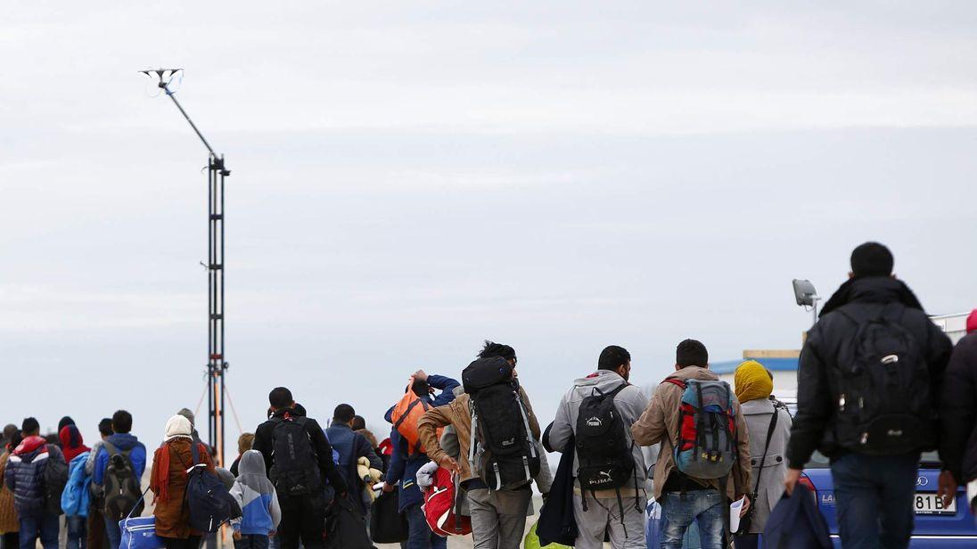Migrants arrive at a registration camp in Erding, near Munich, Germany