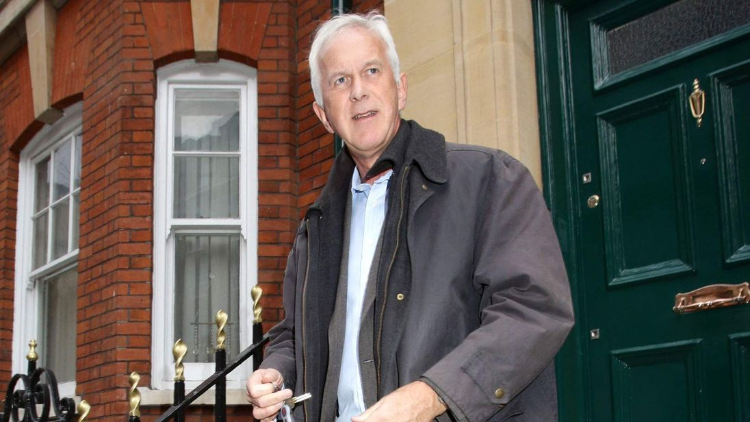 Environment Agency chairman Sir Philip Dilley leaves his flat in Marylebone, London.