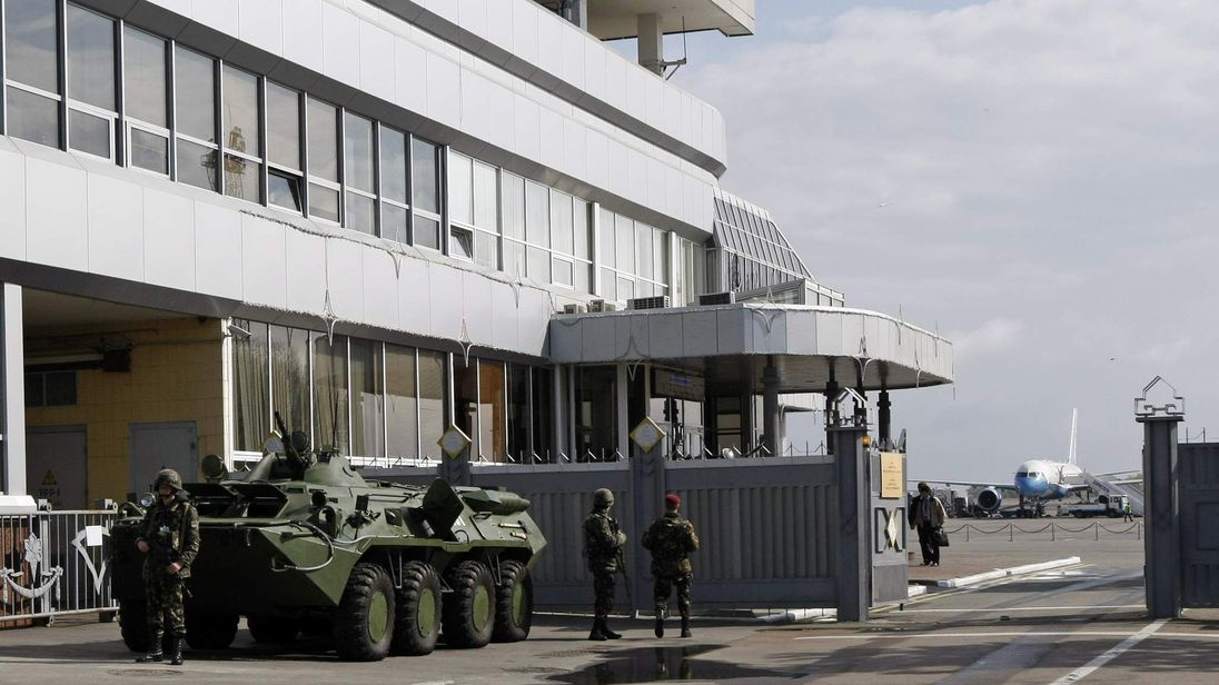 Ukrainian servicemen stand guard near an APC during a ceremony to welcome Joe Biden at Boryspil International airport outside Kiev