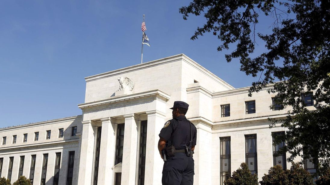 Police officer keeps watch at the The Federal Reserve in Washington