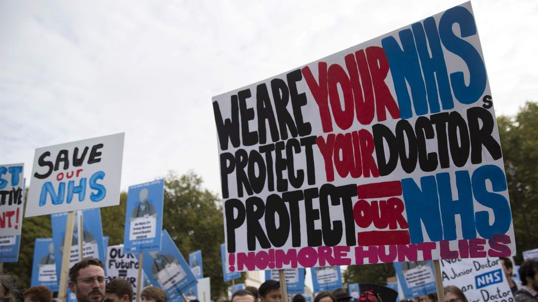 Protesters hold banners at a demonstration in support of junior doctors in London