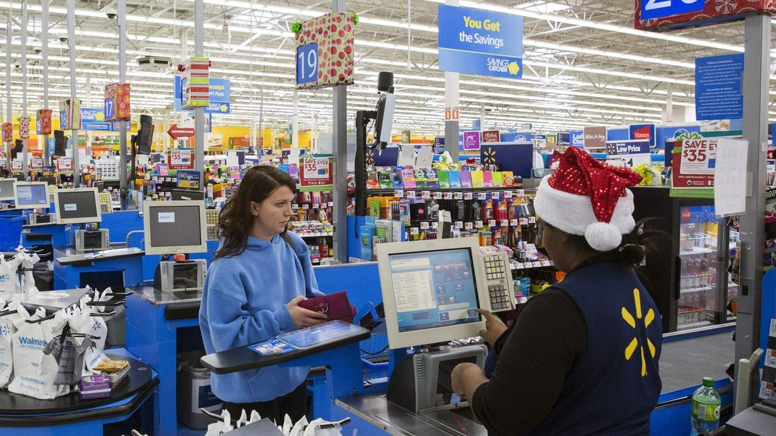A shopper checks out at a Walmart store in Secaucus, New Jersey