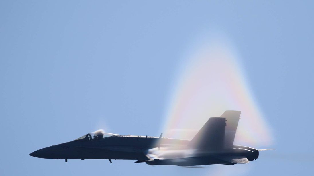 A Marine Corps F/A-18 Hornet from Naval Air Station Oceana Virginia, makes a high speed pass during the Canadian International Air Show in Toronto