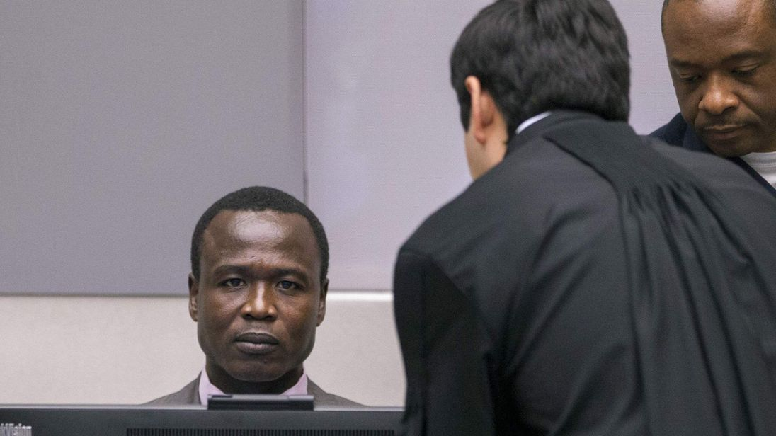 Dominic Ongwen of Uganda sits in the courtroom of the International Criminal Court during the confirmation of charges in The Hague