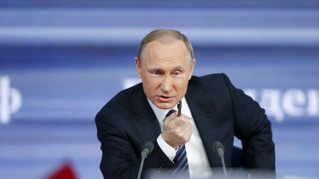 Vladimir Putin attends his annual end-of-year news conference in Moscow