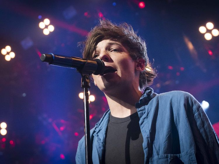 One Direction's Louis Tomlinson on stage
