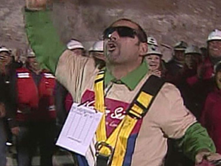 Mario Sepulveda cheers as he becomes the second miner to be rescued from the San Jose mine in Chile