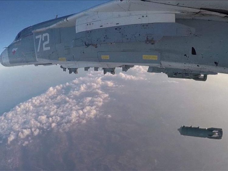 A Russian jet drops bombs on targets in Syria.