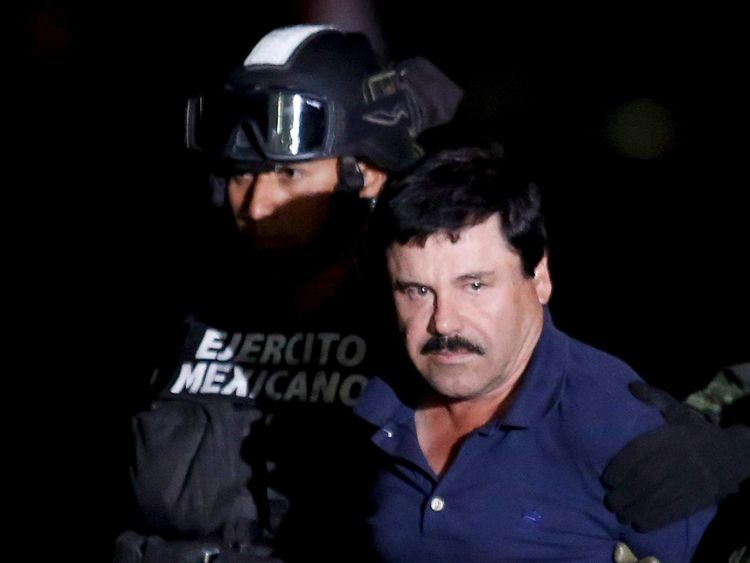 "Joaquin ""El Chapo"" Guzman is escorted by soldiers during a presentation in Mexico City"