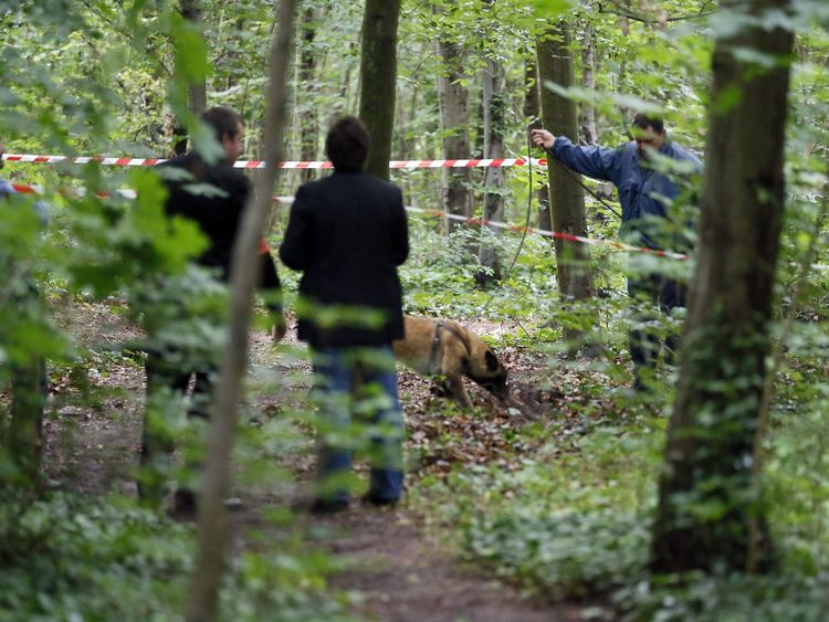 French police with sniffer dog search the Bois der Vincennnes in Paris