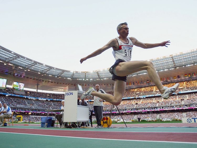 Jonathan Edwards of Great Britain flies through the air during the men's triple jump final at the 9th IAAF World Athletics Championship