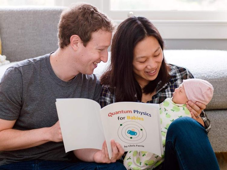 Mark Zuckerberg and Priscilla Chan read a physics took to their baby Max