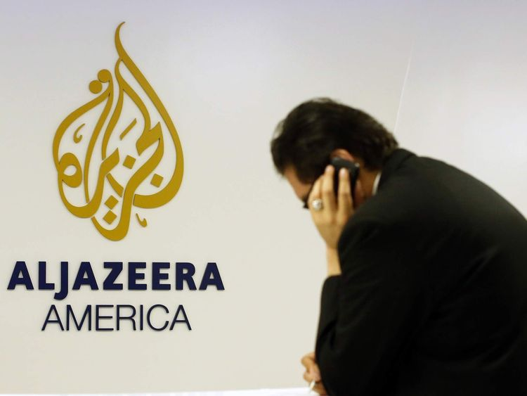 A man works at a desk in the Al Jazeera America broadcast center in New York,