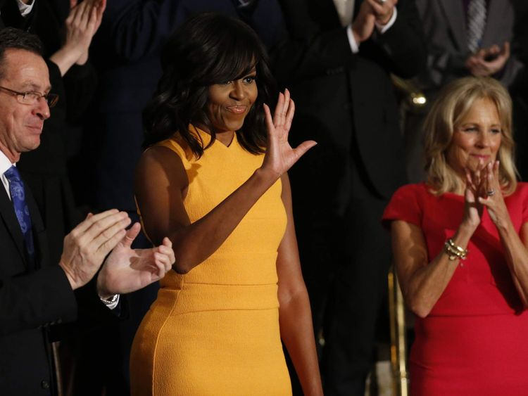 U.S. first lady Michelle Obama waves as she attends U.S. President Barack Obama's State of the Union address to a joint session of Congress in Washington