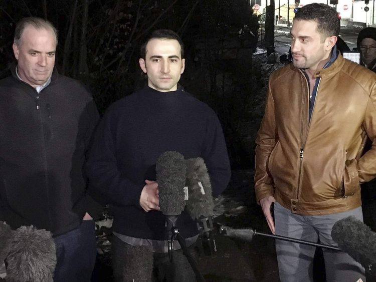 Amir Hekmati, flanked by U.S. Congressman Dan Kildee and brother-in-law Ramy Kurdi, speaks with media in Landstuhl