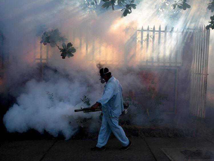 A worker fumigates to prevent Zika virus in Managua, Nicaragua