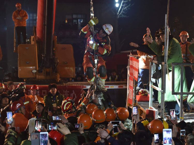 A trapped worker is lifted from a collapsed coal mine after 36 days of rescue, in Pingyi