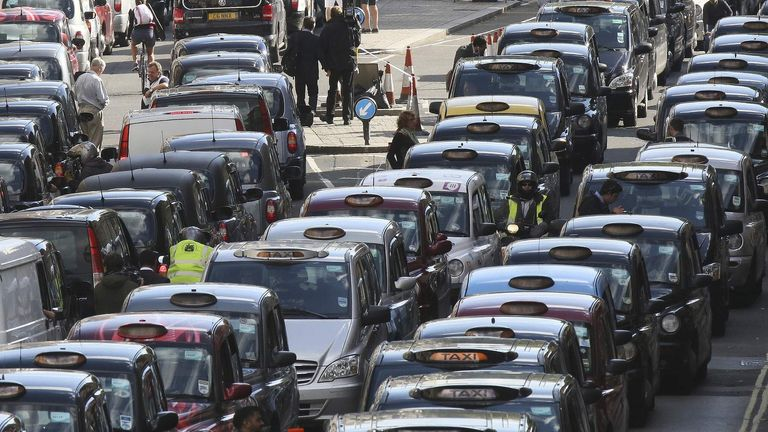 London black cabs clog up Whitehall during a protest against Uber and other ride-sharing services