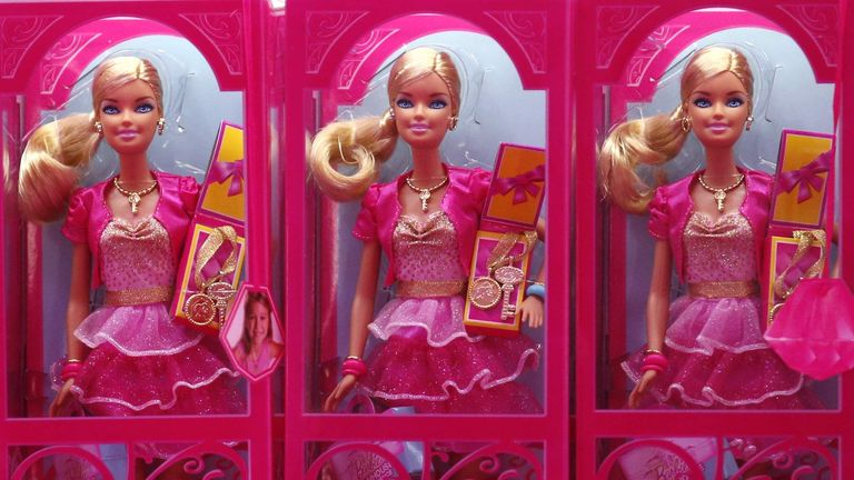 """Mattel's Barbie dolls on sale are pictured inside a shop of a life-size """"Barbie Dreamhouse"""" during a media tour in Berlin"""