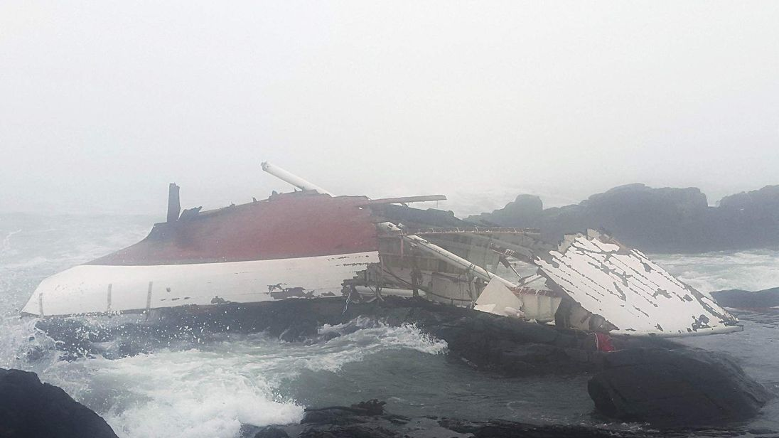 Handout photo issued by the National Sea Rescue Institute South Africa of a Yacht which ran into trouble and was found crashed into rocks on the western coast of South Africa.