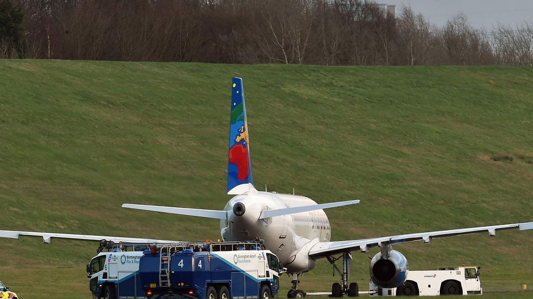 Plane leaves runway at Birmingham Airport