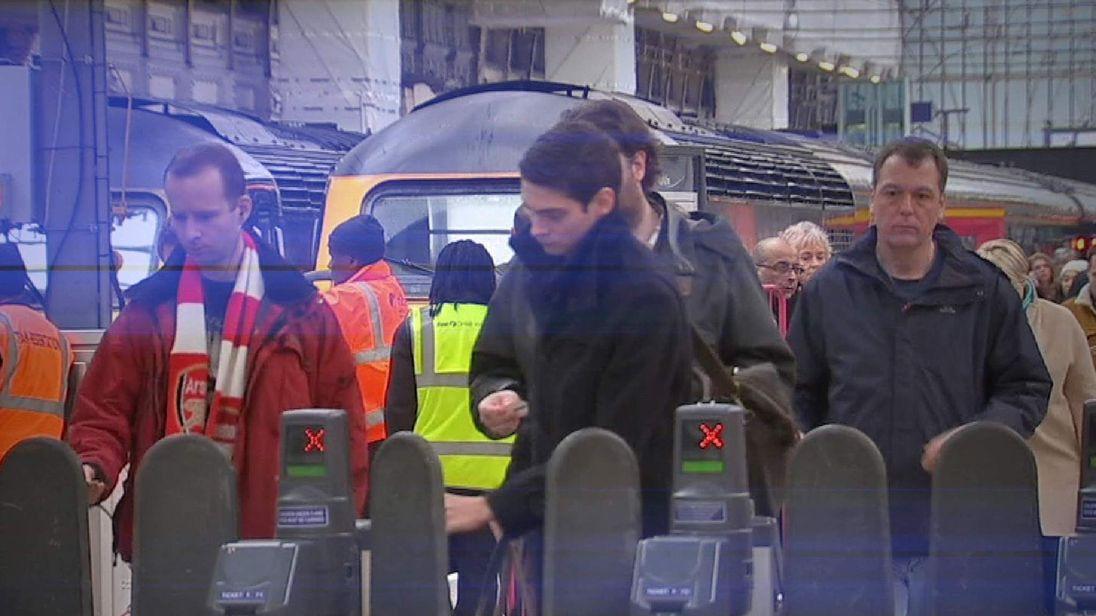 Passengers at Paddington Station as rail fares increase