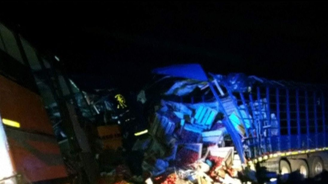The bus crashed into a lorry carrying tomatoes