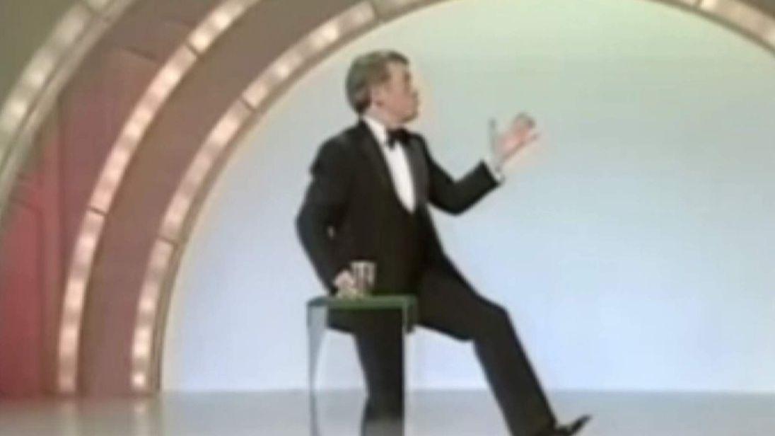 Paul Daniels doing a magic trick