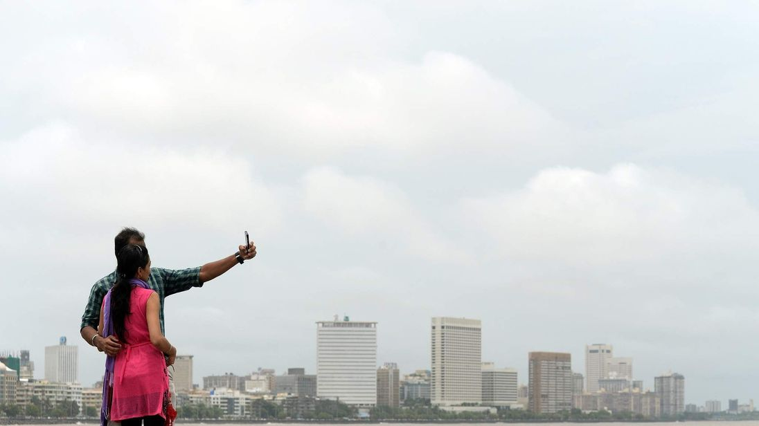 A couple take a selfie on Marine Drive in Mumbai, India
