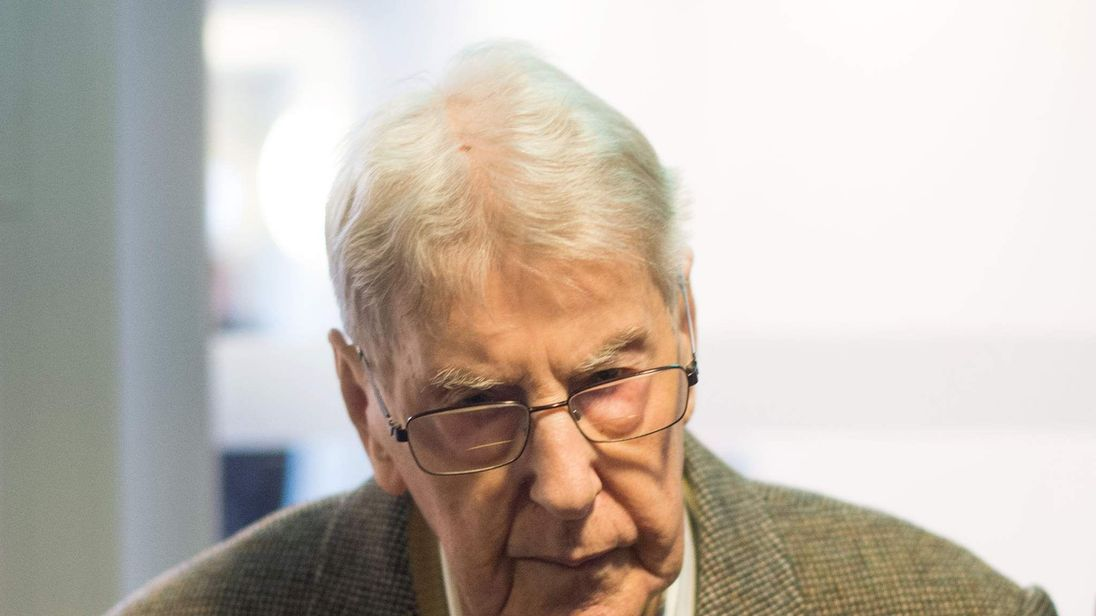 Former Auschwitz guard Reinhold Hanning arrives for his trial in Detmold