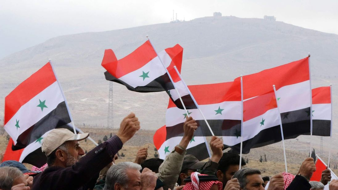 Syrian volunteers and their relatives at the end of military training