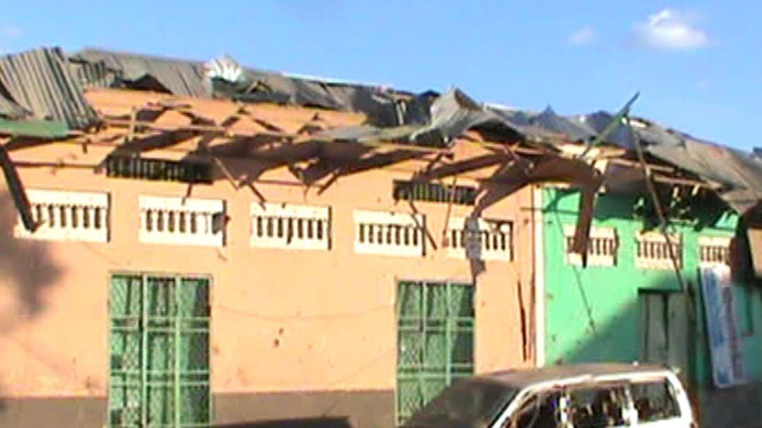 Destroyed buildings and vehicles in Baidoa after twin explosions in the Somali city killed at least 30 people