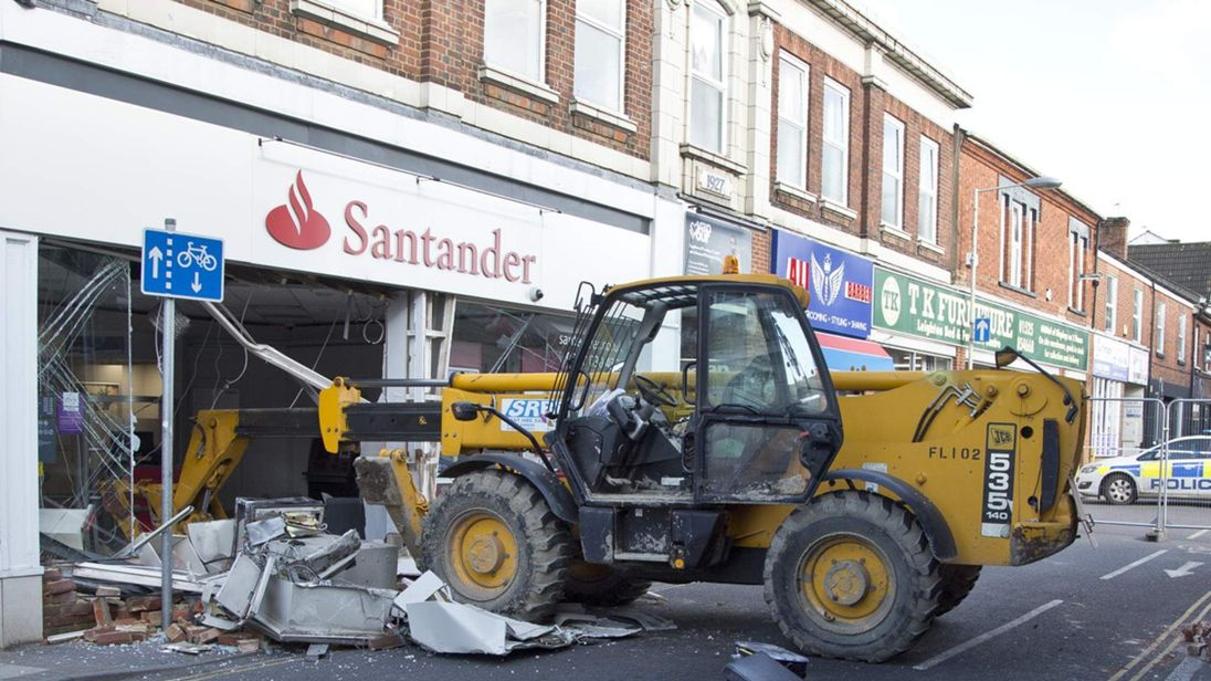 A JCB crashes into a Santander Bank in Leighton Buzzard