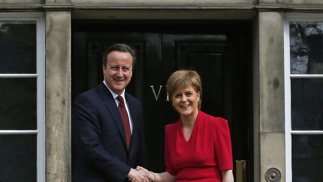 Scotland's First Minister Nicola Sturgeon greets Britain's Prime Minister David Cameron as he arrives for their meeting in Edinburgh
